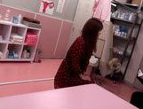 Japanese AV Model is a hot milf in a nasty doctors exam room picture 12