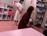 Japanese AV Model is a hot milf in a nasty doctors exam room picture 13
