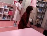 Japanese AV Model is a hot milf in a nasty doctors exam room picture 14