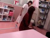 Japanese AV Model is a hot milf in a nasty doctors exam room picture 15