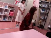 Japanese AV Model is a hot milf in a nasty doctors exam room