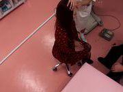 Japanese AV Model is a hot milf in a nasty doctors exam room