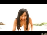 Busty babe Nana Ogura naked at a beach!