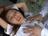 Naughty nurse Rin Sakuragi is examined and rear fucked at the doctor's picture 11