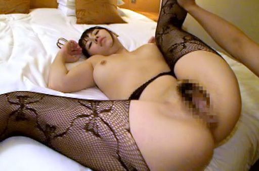 Japanese AV model spreads her moist pink pussy wide open