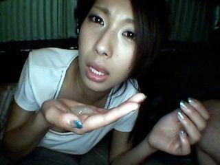 Mai Yuzuki Asian model gives a blowjob in the car