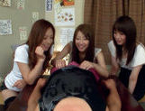 Three Asian girls give a blowjob