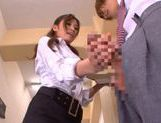 Hot and sexy Japanese porn star student Saki Ayano sucking and stroking a hard cock picture 13