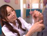 Hot and sexy Japanese porn star student Saki Ayano sucking and stroking a hard cock picture 14