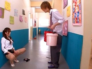 Hot and sexy Japanese porn star student Saki Ayano sucking and stroking a hard cock