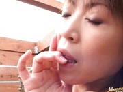 Hot mature Jun Kusanagi posing outside and masturbating on couch.