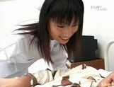 Sexy nurse Saki Budou gives a quick handjob to her male patient