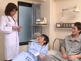 Japanese nurse Erika Nishino plays nasty on two cocks picture 3