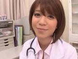 Japanese AV Model is a wild nurse sucking cock picture 2