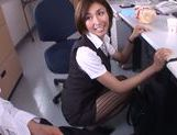 Gorgeous office milf Akari Asahina gives an arousing footjob picture 14