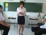 Busty teacher Saki Okuda sucks cock in the classroom