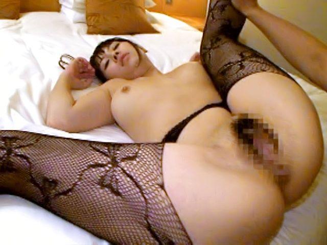 Japanese AV model spreads her moist pink pussy wide open