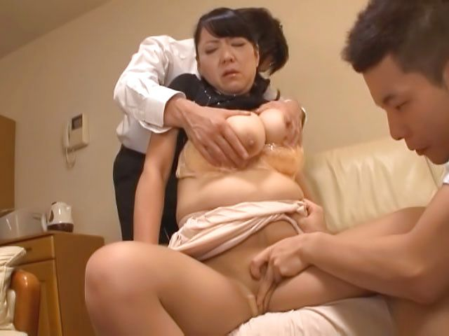 Busty Japanese mature Emiko Ejima gives hot double blowjob
