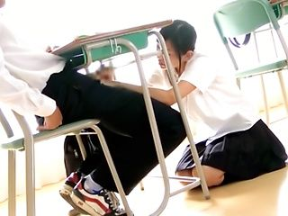 Kinky school girl sucks cock like an experienced milf in classroom.
