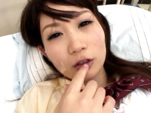 Japanese schoolgirl's face covered in thick cum